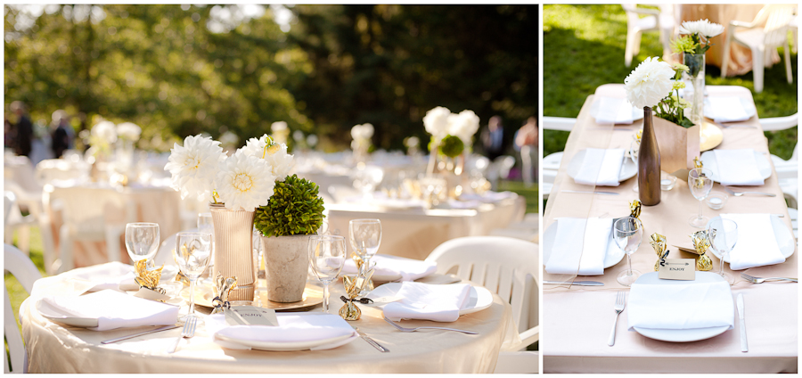 Outdoor wedding reception table with gold and white details.
