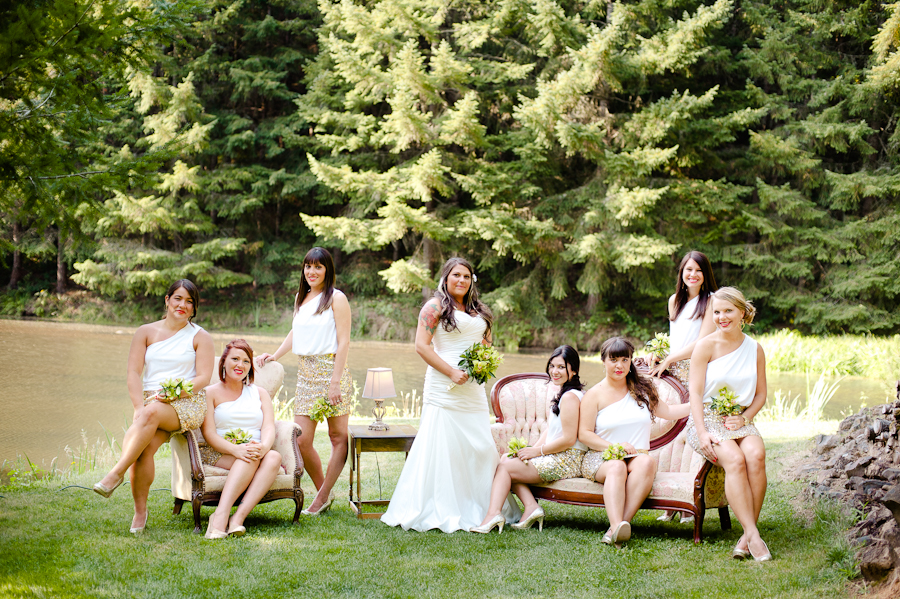 Bridesmaids in gold sequin skirts sitting on vintage furniture.