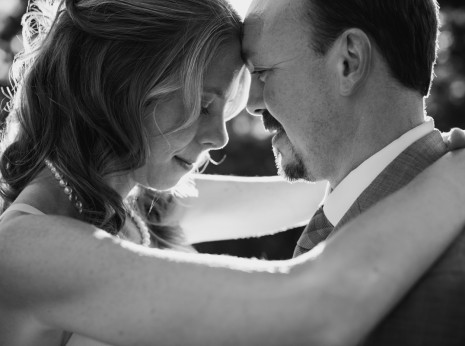 bride and groom close up black and white with glowing backlight