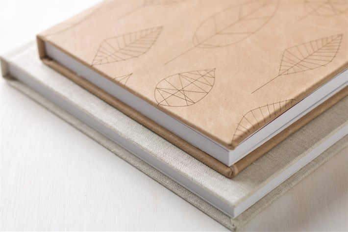 Etched leather covers